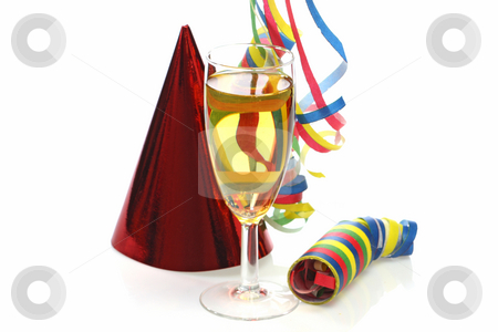 Streamers stock photo, Glass of champagne with party hats and streamers on bright background by Birgit Reitz-Hofmann