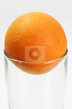 One orange stock photo, Glass with orange on bright background by Birgit Reitz-Hofmann