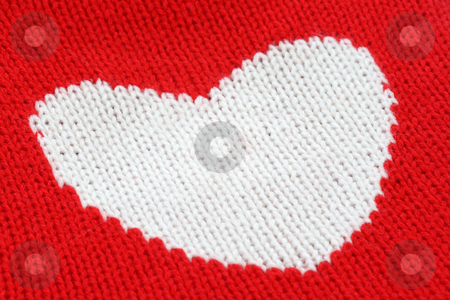 Knitting Heart stock photo, Close up from white knitting heart on red. by Birgit Reitz-Hofmann