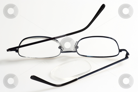 Eye glass stock photo, Broken eye glasses on bright background. by Birgit Reitz-Hofmann