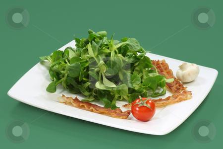 Field salad stock photo, Field salad on a plate on green background by Birgit Reitz-Hofmann