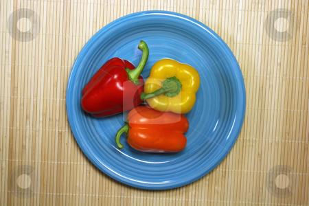 Raw paprica stock photo, Paprica on the plate on brown bakcground by Birgit Reitz-Hofmann