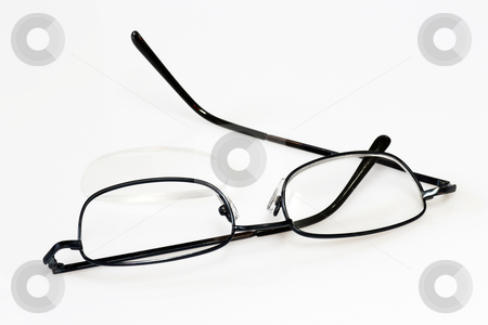 Eye glass stock photo, Broken eye glasses on bright background. by Birgit Reitz-Hofmann