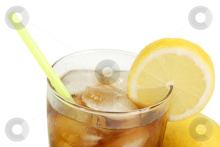 Lemon ice tea_7 stock photo, A glass full of Ice Tea with a lemon slice on bright background by Birgit Reitz-Hofmann