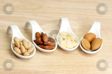 Almonds variety stock photo, Studio closeup shot of brown almonds by Birgit Reitz-Hofmann