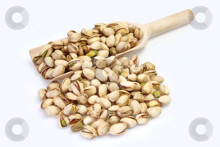 Pistachios stock photo, Pistachios on a wood shovel on bright background by Birgit Reitz-Hofmann