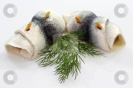 Rolled herring stock photo, Rolled herring on bright background. Shot in studio. by Birgit Reitz-Hofmann