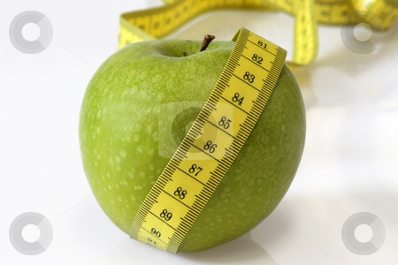 Green apple stock photo, Green apple and measuring tape; diet image by Birgit Reitz-Hofmann