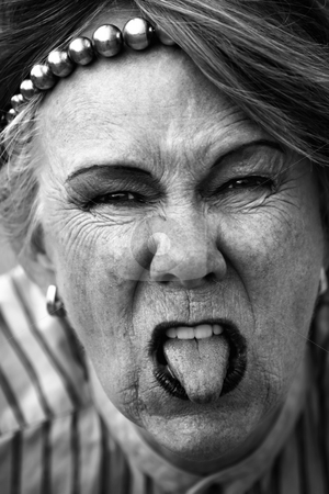 Rude old woman stock photo, Closeup of rude old woman sticking out her tongue by Scott Griessel