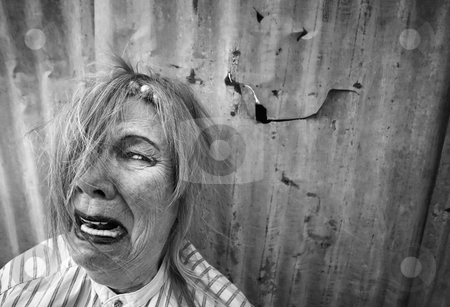 Homeless Woman Crying stock photo, Senior homeless woman with too much makeup crying by Scott Griessel