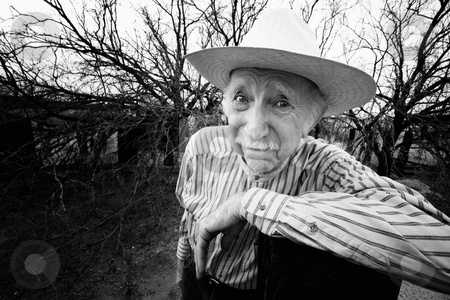 Rancher with sad eyes stock photo, Elderly rancher with sad eyes in a straw hat by Scott Griessel