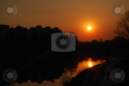 Cityscape stock photo, Reflection of the sunset and buildings in water by Leyla Akhundova
