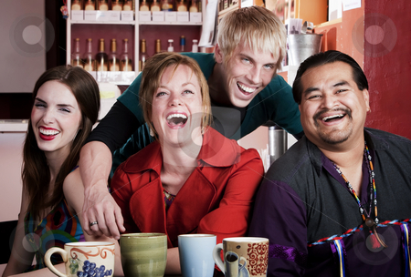 Friends in a Coffee House stock photo, Four friends posing in a coffee house by Scott Griessel