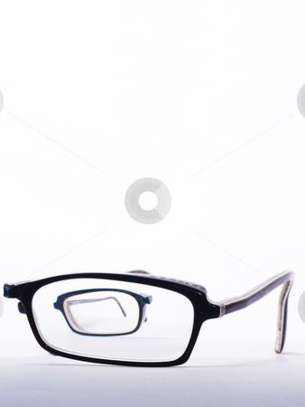 Broken eyeglasses stock photo, Broken eyeglasses one half to be seen throug glass of the other half by Torsten Lorenz