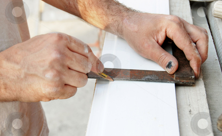 Working stock photo, Manual worker hands drawing a line  on white plastic track by Julija Sapic