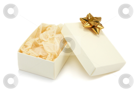 Open Gift Box with Bow stock photo, A open cream textured cardboard gift box with a gold metallic bow and crumpled tissue paper on a white background by Helen Shorey
