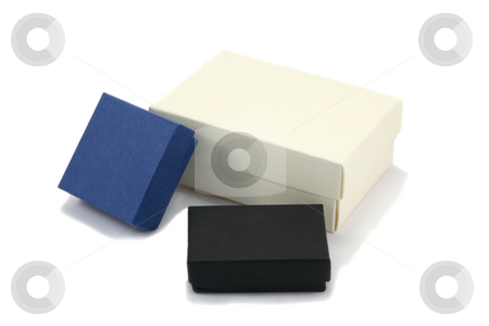 Three Varied Gift Boxes stock photo, Three gift boxes of various sizes in black, blue and cream coloured cardboard, isolated on white background by Helen Shorey