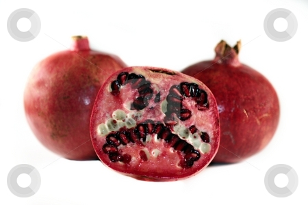 Pomegranate stock photo, Red yummy juicy pomegranate on white background. by Henrik Lehnerer