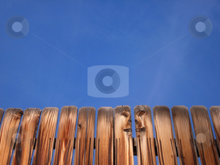 Wooden Fence and Blue Sky stock photo, A clean image with lots of blue sky for copy space and a nice wooden fence across the bottom. by Ben O'Neal