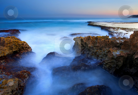 Boiling Tide Pools stock photo, A tidepool  boils beneath the rising water of the incoming tides at dusk. Taken at Penington beach on Kangaroo Island. The jagged limstone required cautian as rocks faces were sharp and jagged, by Mike Dawson