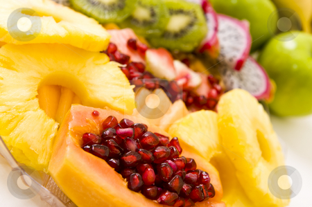 Delicious fresh salad stock photo, Delicious freshly cut fruit salad with pomegranate seeds inside a papaya and other fruit. by Nicolaas Traut
