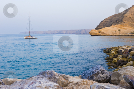 Sailboat anchored in the bay. stock photo, A twin-hulled sailboat anchored in a secluded bay. by Nicolaas Traut