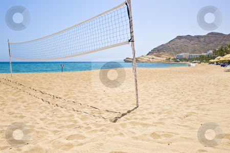 Beach volleyball net stock photo, A volleybal net on an empty beach at a holiday resort. by Nicolaas Traut