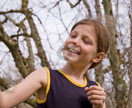 Cute 8 Year Old Girl stock photo, Cute 8 year old girl is playing and looking at something to the side. by Valerie Garner