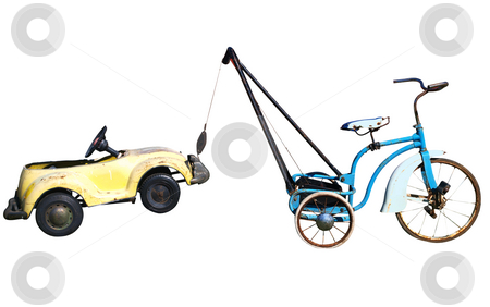 Trike with a Toy Car in Tow stock photo, Trike with a Toy Car in Tow isolated with clipping path by Margo Harrison