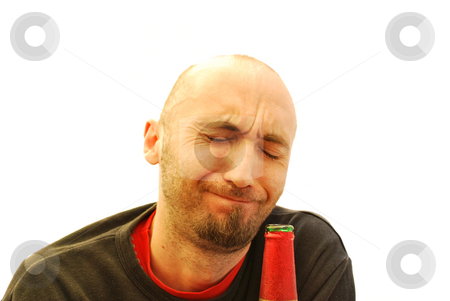 Drunk stock photo, Young man drinking from a bottle of beer by Tudor Antonel adrian