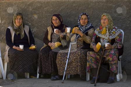 Turkish women stock photo, Turkish women having lunch in the street of Ankara by Kobby Dagan