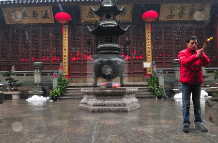 Chinese buddhist shrine  stock photo, Worshiper in Chinese buddhist shrine in the city of Shanghai China by Kobby Dagan