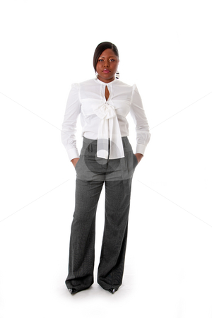 African business woman stock photo, Beautiful African American business woman with attitude dressed in a white shirt and gray pants standing, hands in pocket, isolated by Paul Hakimata