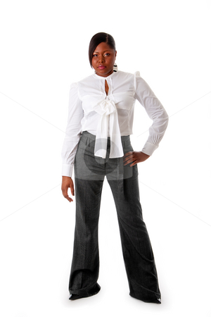 Tough African business woman stock photo, Beautiful African American business woman with tough attitude dressed in a white shirt and gray pants standing, isolated by Paul Hakimata
