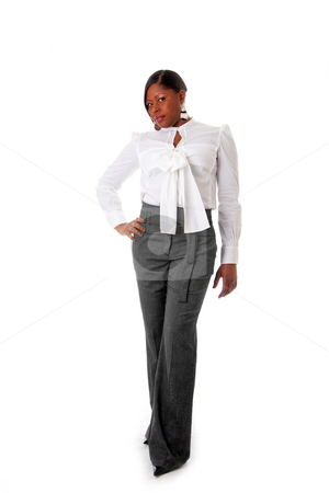 African business woman stock photo, Beautiful African American business woman with attitude dressed in a white shirt and gray pants standing, hands on hip, isolated by Paul Hakimata
