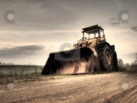 Bulldozer stock photo, Big bulldozer at the building site.Monochrome toned. by Sinisa Botas