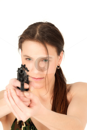 Young woman holding pistol stock photo, Portrait of young woman aiming gun, studio shot by Tom Prokop