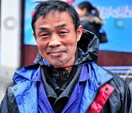 Chinese man stock photo, Portrait of Chinese man in Shanghai China by Kobby Dagan