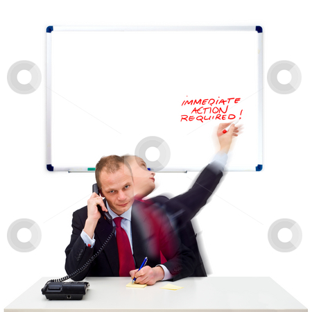 Immediate action required stock photo, A businessman taking immediate action after receiving a telephone call from a client by Corepics VOF