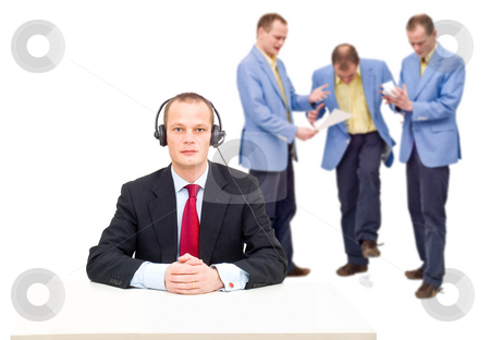 Failure to communicate stock photo, A manager, incapable of hearing the angry voices of his employees, a conceptual image of the failure to communicate in big organisations. by Corepics VOF