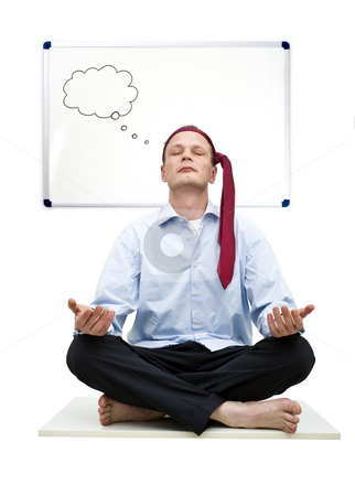 Business Zen stock photo, A smartly dressed business man practicing Zen in deep concentration and thought in front of a white board with an empty thought cloud by Corepics VOF