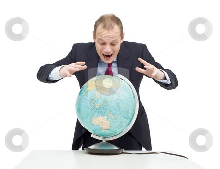 Global fortune stock photo, A businessman, hovering over a globe as if if looking at a fortune teller's sphere, seeing the possibilities and potential of emerging markets and global business by Corepics VOF