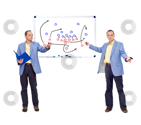 Football strategy stock photo, A coach drilling his team with the strategy and tactics of a football game. by Corepics VOF