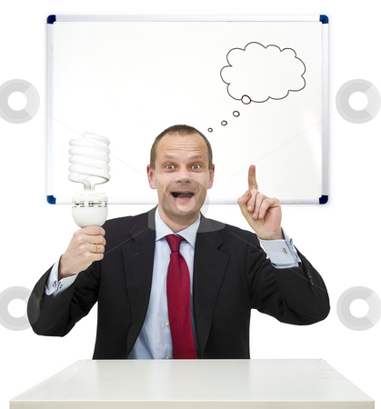 Idea and innovation stock photo, A businessman, smartly dressed in a suit, holding a lamp, illustrating the idea and innovation process. On the whiteboard behind him, a schematic innovation funnel is drawn by Corepics VOF