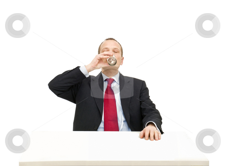 Drinking water stock photo, A businessman in a formal suit and necktie drinking a glass of water by Corepics VOF