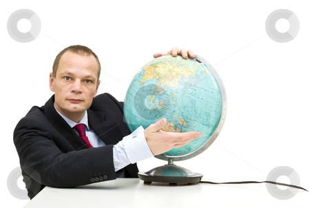 Emerging market stock photo, A businessman wearing a suit presenting an oldfashioned globe, with Asia in front, illustrating emerging markets by Corepics VOF