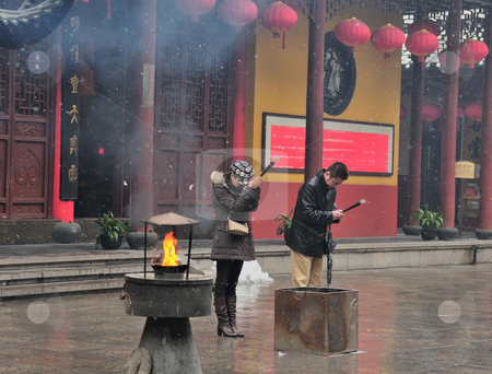 Chinese buddhist shrine  stock photo, Worshipers in Chinese buddhist shrine in the city of Shanghai China by Kobby Dagan
