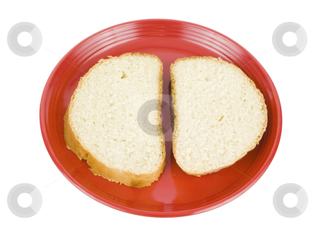 Bread sliced on plate stock photo, White bread sliced on a red plate by John Teeter
