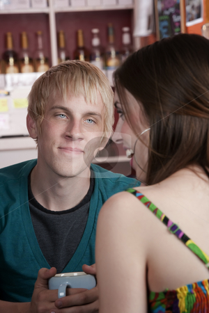 Young man with female friend stock photo, Young man with female friend in a coffee house by Scott Griessel