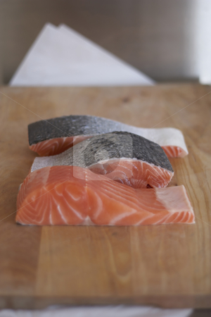 Raw produce - fresh Salmon fillets stock photo, Fresh Salmon fillets, placed on wooden chopping board, shallow focus by Gary Cookson